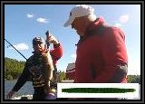 Dan checks out the weight of this 2 1/2 lb Largemouth Bass AL caught