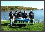 "theBASSguys team taking a lunch break. We had planned on a cold week and lots of Smallmouth Bass for this time of the year.. Unfortunately, the weather was hot all week and the ""Smally's"" went deep"
